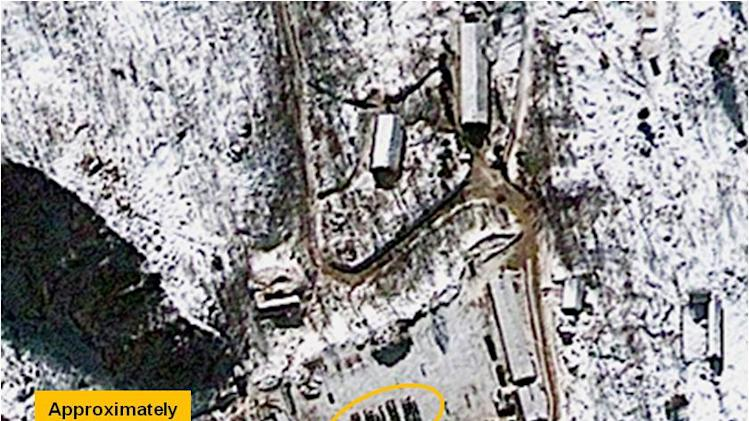 This Jan. 4, 2013 satellite image provided by GeoEye shows North Korea's Punggye-ri nuclear test facility. This and other recent satellite photos show North Korea could be almost ready to carry out its threat to conduct a nuclear test, a U.S. research institute said Friday, Jan. 25, 2013. The images of the Punggye-ri site where nuclear tests were conducted in 2006 and 2009 reveal that over the past month roads have been kept clear of snow and that North Koreans may be sealing the tunnel into a mountainside where a nuclear device would be detonated. But it remains difficult to discern North Korea's true intentions as a test would be conducted underground. The analysis was provided to The Associated Press by 38 North, the website of U.S.-Korea Institute at Johns Hopkins School of Advanced International Studies. (AP Photo/GeoEye Satellite Image)
