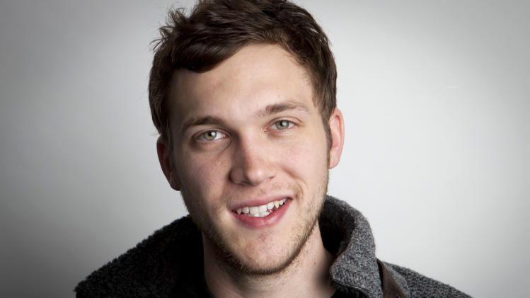 "In this Tuesday, Nov. 13, 2012 photo, American singer-songwriter and winner of the eleventh season of American Idol, Phillip Phillips, Jr. poses for a portrait in New York. In true ""American Idol"" fashion where winners need to strike while the iron's hot, Phillips didn't have a lot of time to record his debut album, ""The World From the Side of the Moon,"" which is now in stores. In fact, he only had three weeks. (Photo by Amy Sussman/Invision/AP)"
