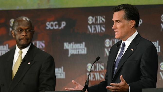 Republican presidential candidates Mitt Romney, right, speaks, as Herman Cain listens during the CBS News/National Journal foreign policy debate at the Benjamin Johnson Arena, Saturday, Nov. 12, 2011 in Spartanburg, S.C. (AP Photo/Richard Shiro)