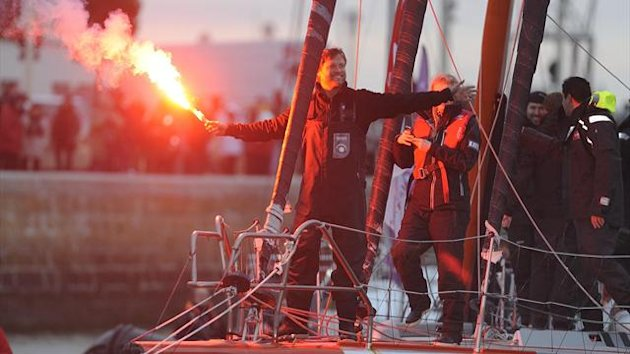 British skipper Alex Thomson celebrates on his monohull &quot;Hugo Boss&quot; after finishing third the 7th edition of the Vendee Globe solo round-the-world race (AFP)