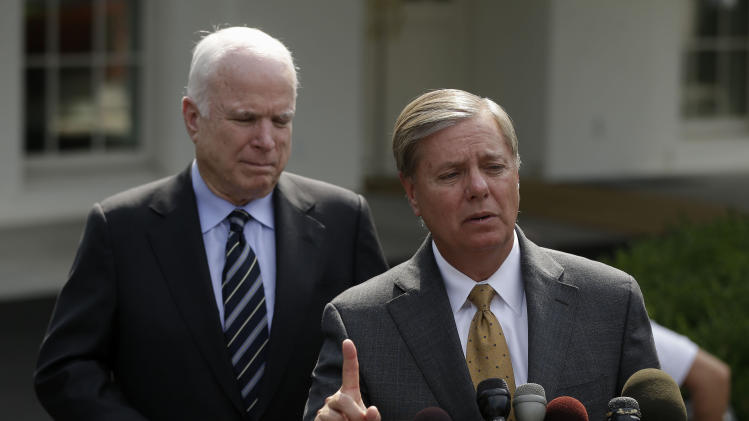 Sen. Lindsey Graham, R-S.C., right, accompanied by Sen. John McCain, R-Ariz., speaks with reporters outside the White House in Washington, Monday, Sept. 2, 2013, following a closed-door meeting with President Barack Obama to discuss the situation with Syria. President Barack Obama, working to persuade skeptical lawmakers to endorse a U.S. military intervention in civil war-wracked Syria, hosted the two leading Capitol Hill foreign policy hawks for talks and directed his national security team to testify before Congress in a determined effort to sell his plan for limited missile strikes against Syrian President Bashar Assad's regime. (AP Photo/Pablo Martinez Monsivais)