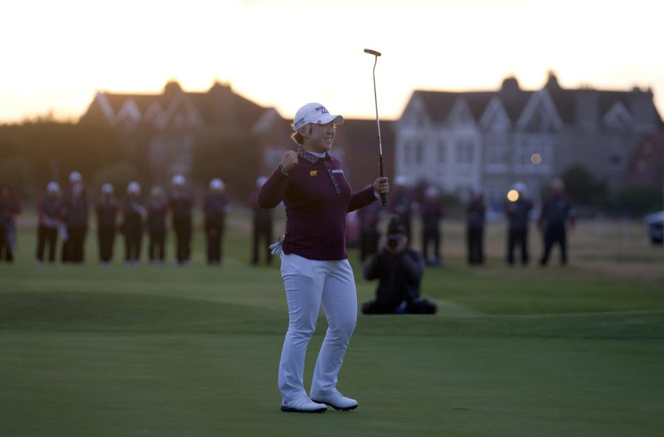 Korea's Jiyai Shin celebrates after winning the Women's British Open golf championships at Royal Liverpool Golf Club, Hoylake, England, Sunday Sept. 16, 2012.  (AP Photo/Jon Super)
