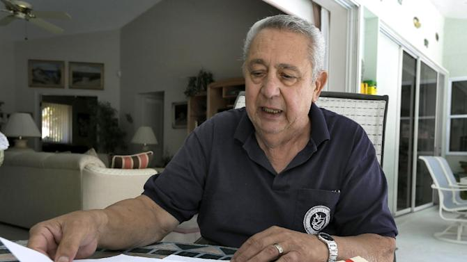 Tom Gervasi looks over some his Department of Veterans Affairs rejection letters Thursday, March 21, 2013, in Sarasota, Fla. Gervasi is a Marine Corps veteran who is dying of breast cancer that is believed to have been caused by contaminated drinking water at Camp Lejeune in the 1950's. (AP Photo/Chris O'Meara)