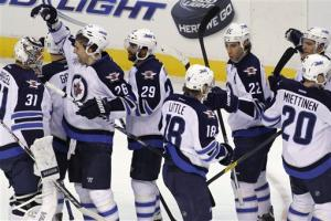Jets mount comeback, beat Capitals 3-2 in shootout