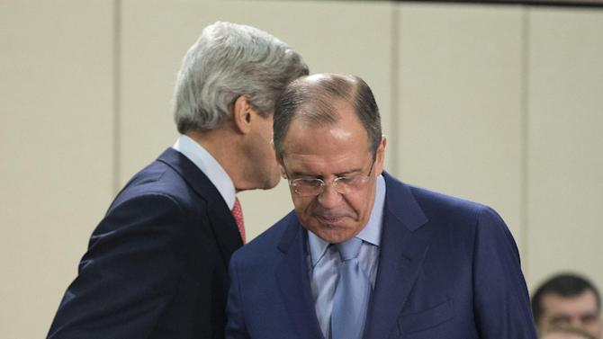 U.S. Secretary of State John Kerry, left, walks away after speaking with Russian Foreign Minister Sergei Lavrov before the start of the NATO- Russia Council meeting at NATO headquarters on Tuesday, April 23, 2013, in Brussels, Belgium. (AP Photo/Evan Vucci, Pool)