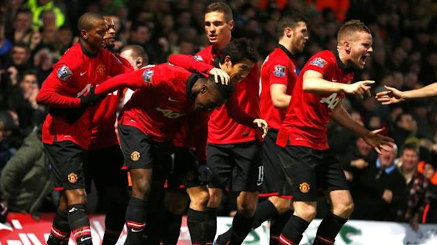 Manchester United celebrate Danny Welbeck scoring at Norwich City (Reuters)