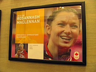 Rosie MacLennan's photo hanging in Canada Olympic House.