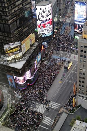 Demonstrators affiliated with the Occupy Wall Street rally in New York's Times Square, Saturday, Oct. 15, 2011. (AP Photo/Mary Altaffer)