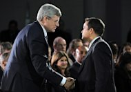 Prime Minister Stephen Harper shakes hands with Shawn Atleo, National Chief of the Assembly of First Nations, during the closing ceremonies of the Crown First Nations Gathering in Ottawa on Tuesday, January 24, 2012. The Conservative government is poised to finally unveil its retooled plan to reform First Nations education.THE CANADIAN PRESS/Sean Kilpatrick