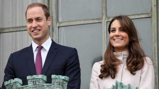 Catherine and William smile at crowds from the balcony of the Cambridge Guildhall during an official visit on Nov. 28.