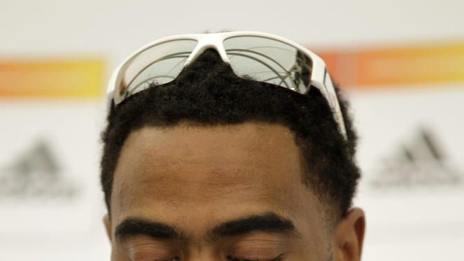 Injured U.S. sprinter Tyson Gay looks down as he takes part in a news conference for the World Athletics Championships at the stadium in Daegu, South Korea, Thursday, Aug. 25, 2011.   The World Athletics Championships run Aug. 27 through Sept. 4, 2011 in Daegu. (AP Photo/Matt Dunham)