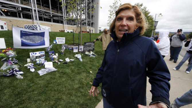 Gayle Barnes, a member of the jury that convicted former Penn State assistant football coach Jerry Sandusky, stands outside Beaver Stadium on Saturday, Oct. 6, 2012 in State College, Pa.  Jerry Sandusky should be sent to prison for life when a judge sentences him Tuesday, according to several of the jurors who convicted the former Penn State assistant coach of molesting several boys over a period of years. Barnes, a homemaker and former school district employee, said she thinks a lot about the victims, particularly the eight who testified against Sandusky and provided what she considers the critical evidence of guilt. She said he deserves life in prison. (AP Photo/Gene J. Puskar)