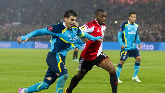 Jose Antonio Reyes of Sevilla fights for the ball with Miguel Nelom of Feyenoord during their Europa League soccer match in Rotterdam