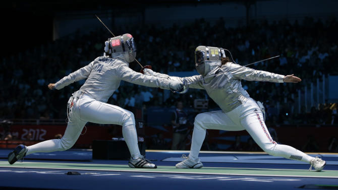 FILE - In this Aug. 12, 2012 file photo Italy's Irene Vecchi, left, competes with Britain's Sophie Williams during women's individual sabre fencing at the 2012 Summer Olympics in London. The inaugural European Games in Baku in 2015 have been approved. The European Olympic Committees voted Saturday, Dec. 8, 2012 to create the multi-sport event in June 2015. The capital of Azerbaijan was the sole candidate. The secret ballot passed with 38 in favor, eight against and three abstaining. (AP Photo/Andrew Medichini, File)