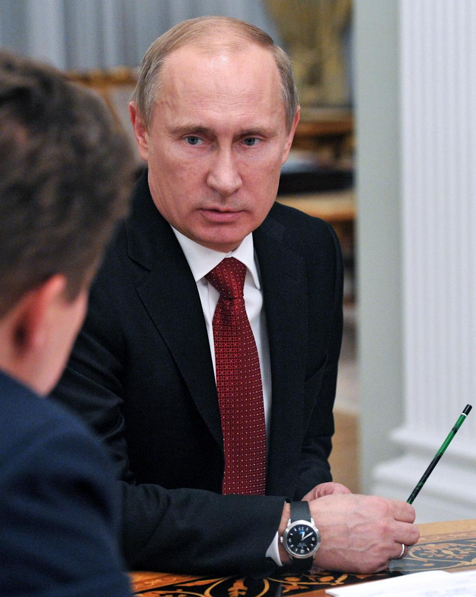 Russian President Vladimir Putin, right, meets with Russian gas monopoly Gazprom head Alexei Miller, partially visible at left, in the Novo-Ogaryovo just outside Moscow, Monday, Oct. 29, 2012. (AP Photo/RIA-Novosti, Alexei Nikolsky, Presidential Press Service)