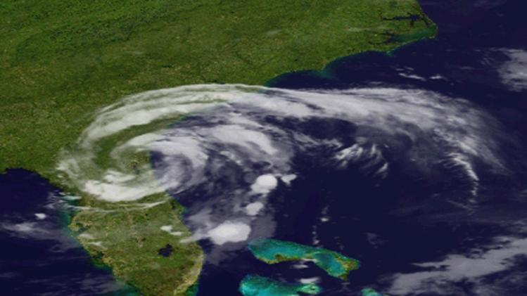 In an image provided by the National Oceanic and Geographic Authority, shows s GOES satellite image of Tropical Storm Beryl as it makes landfall in Florida early Sunday May 28, 2011.  The storm made landfall in northeastern Florida, bringing drenching rains and driving winds to the southeastern U.S. coast, forecasters said.  (AP Photo/NOAA)