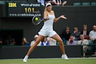 Russia's Maria Sharapova plays a forehand during her Wimbledon second round women's singles match against Bulgaria's Tsvetana Pironkova on June 27. Sharapova was leading when bad light halted play on Court One