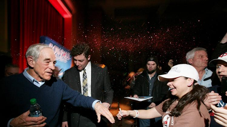 Republican Presidential candidate Ron Paul is glitter-bombed as he greets the crowd after speaking at a rally at the Minneapolis Convention Center Feb 6, 2012.  (Courtney Perry/Special to the Star Tribune) Minneapolis Area TV  Out  MAGS OUT