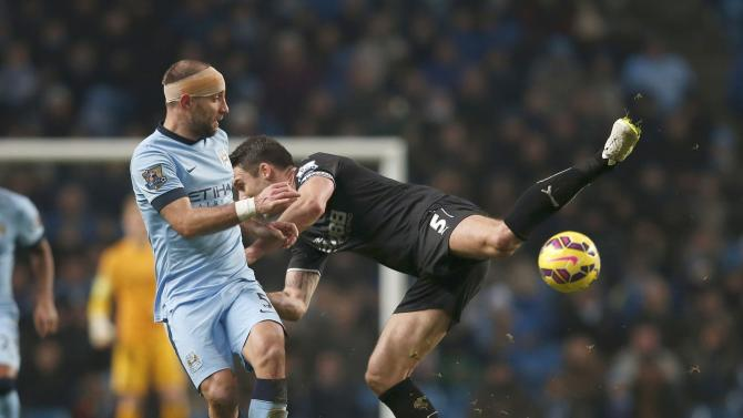 Manchester City's Pablo Zabaleta challenges Burnley's Jason Shackell during their English Premier League soccer match at the Etihad Stadium in Manchester