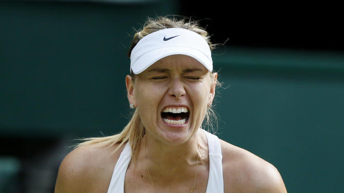 Maria Sharapova of Russia reacts after breaking serve during her match against Coco Vandeweghe of the U.S.A. at the Wimbledon Tennis Championships in London
