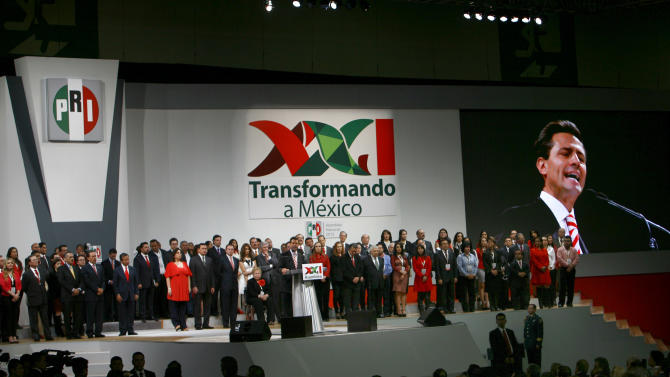 Mexico's President Enrique Pena Nieto delivers a speech during a national convention of the Institutional Revolutionary Party (PRI) in Mexico City, Sunday, March 3, 2013. Mexico's ruling party changed on Sunday its platform to allow a reform that could bring private investment into the state-owned oil monopoly, in a country where oil is a source of national pride. (AP Photo/Marco Ugarte)