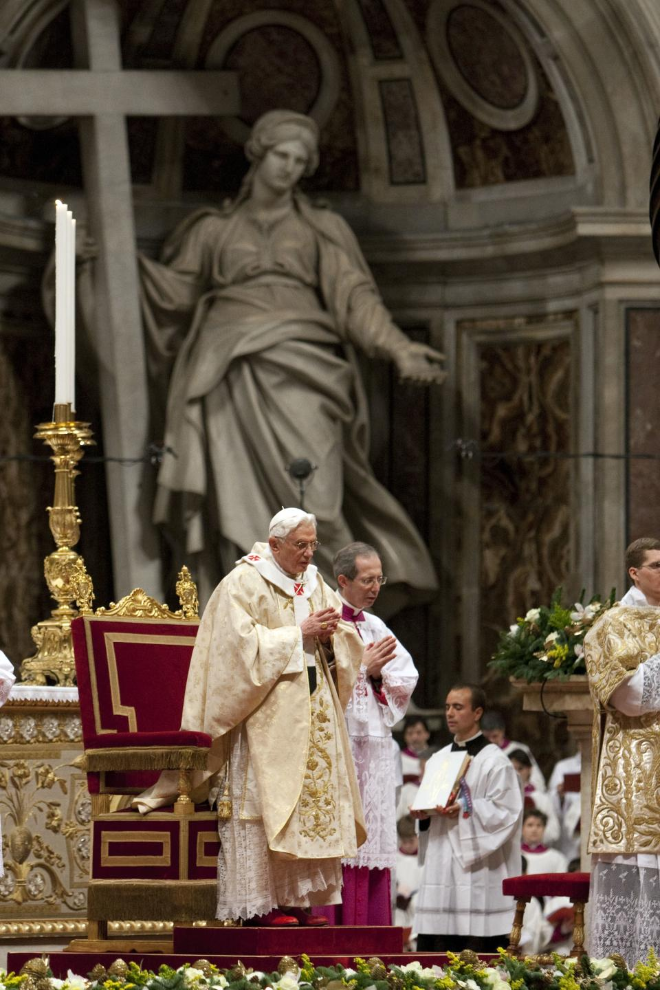 Pope Benedict XVI celebrates Christmas Mass in St. Peter's Basilica at the Vatican, Saturday, Dec. 24, 2011. (AP Photo/Andrew Medichini)