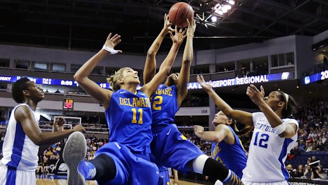 Delaware forwards Elena Delle Donne (11) and Danielle Parker, third from right, grab a rebound against Kentucky forwards Jelleah Sidney, right, and Samarie Walker, left, during the first half of a regional semifinal in the women's NCAA college basketball tournament in Bridgeport, Conn., Saturday, March 30, 2013. (AP Photo/Charles Krupa)