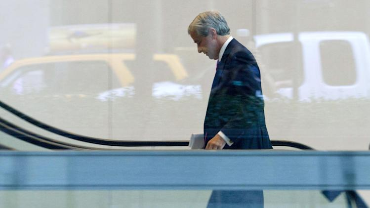 JPMorgan Chase CEO Jamie Dimon enters the company headquarters, Friday, July 13, 2012, in New York. JPMorgan Chase, the largest bank in the United States, said Friday that its loss from a highly publicized trading blunder had grown to $4.4 billion in the most recent quarter, more than double the bank's original estimate of $2 billion. (AP Photo/Jin Lee)