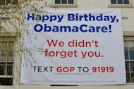 "A banner marking the anniversary of ""ObamaCare"" is seen outside of the Republican National Committee office in March, 2012 in Washington, DC. The imminent US Supreme Court decision on Barack Obama's signature health care reforms has major implications for November's presidential election and for the future of the United States"