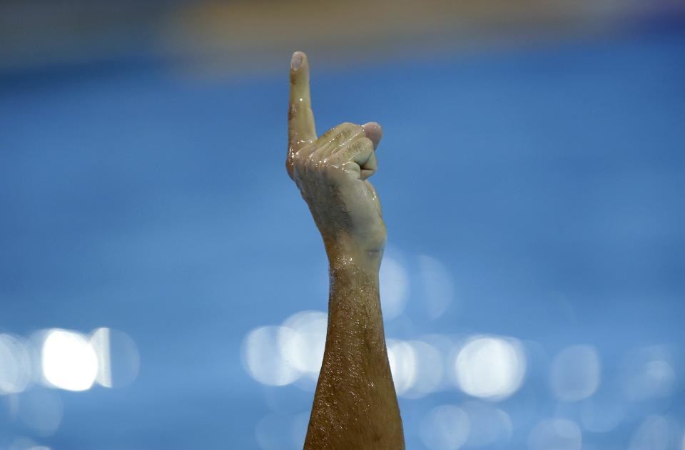 Danijel Premus of Italy gestures after scoring a goal against Australia in a preliminary water polo match at the 2012 Summer Olympics, Sunday, July 29, 2012, in London. (AP Photo/Julio Cortez)