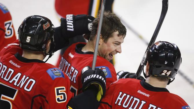 Butler scores in OT, Flames edge Hurricanes 2-1
