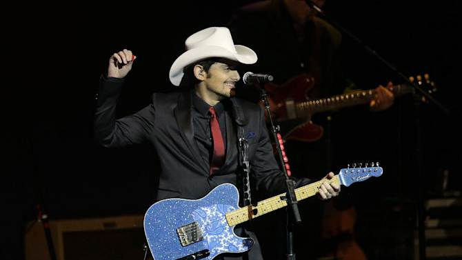 """FILE - Brad Paisley performs during The Inaugural Ball at the Washignton convention center during the 57th Presidential Inauguration in Washington on Monday, Jan. 21, 2013. Southern white men don't usually drive racial dialogue. For as long as race has riven America, they have been depicted more often as the problem than the solution. So the country music star must have been unsurprised at the days of widespread criticism of his new song """"Accidental Racist,"""" which details the challenges facing a """"white man from the southland"""" and then features LL Cool J rapping from a black perspective. (AP Photo/Paul Sancya)"""