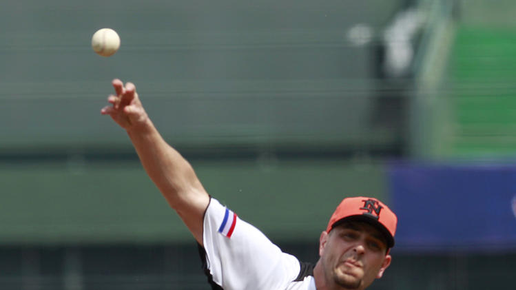 The Netherlands' starter Rob Cordemans delivers a pitch against Australia in the first inning of their World Baseball Classic first round game at the Intercontinental Baseball Stadium in Taichung, Taiwan, Tuesday, March 5, 2013. The Netherlands won 4-1. (AP Photo/Wally Santana)