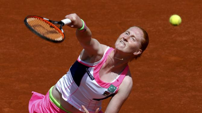 Alison Van Uytvanck of Belgium plays a shot to Kristina Mladenovic of France during their women's singles match at the French Open tennis tournament at the Roland Garros stadium in Paris