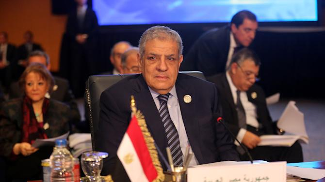 Prime Minister Ibrahim Mehleb attends an Arab foreign ministers meeting during an Arab summit in Sharm el-Sheikh, South Sinai, Egypt, Sunday, March 29, 2015.  Arab League member states have agreed in principle to form a joint inter-Arab military peacekeeping force. The agreement is a telling sign of a new determination among Saudi Arabia, Egypt and their allies to intervene aggressively in regional hotspots, whether against Islamic militants or spreading Iranian power. (AP Photo/Thomas Hartwell)