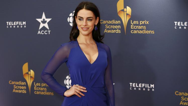 Actress Jessica Lowndes arrives on the red carpet at the 2014 Canadian Screen awards in Toronto