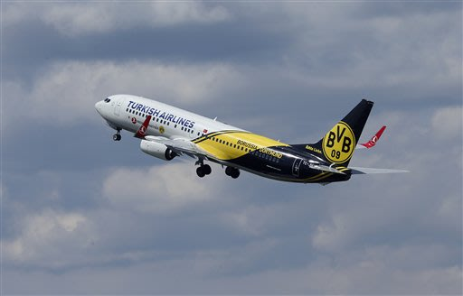 The plane with Borussia Dortmund soccer players  takes off the airport in Dortmund, Germany, Friday, May 24, 2013. The soccer team of Dortmund is on it's way to London for the Champions League Final b