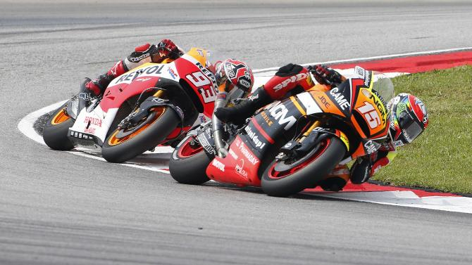 Honda MotoGP rider Marquez of Spain and Forward Yamaha rider De Angelis of Republic of San Marino ride during the warm up session of the Malaysian Motorcycle Grand Prix at Sepang International Circuit near Kuala Lumpur