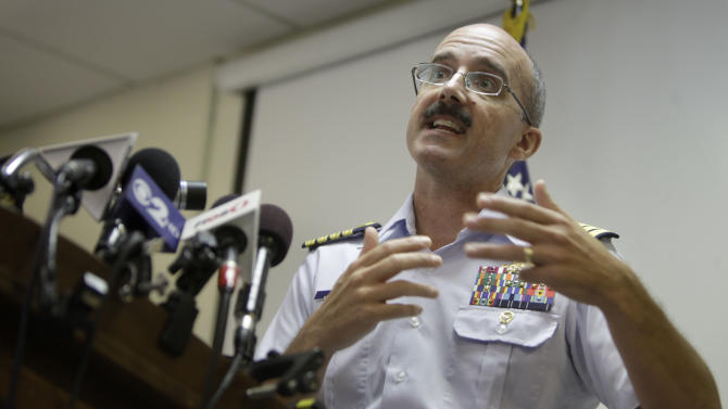 Deputy Commander of Coast Guard Sector New York Capt. Gregory Hitchen speaks during a news conference in New York, Tuesday, June 12, 2012. The Coast Guard says a reported explosion on a motor yacht off central New Jersey likely was a hoax and that an extensive search and rescue operation cost hundreds of thousands of dollars. (AP Photo/Seth Wenig)