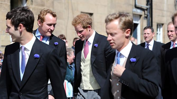 Britain's Prince Harry, centre, arrives at the wedding of the Duke and Duchess of Northumberland's daughter Lady Melissa Percy to chartered surveyor Thomas van Straubenzee at St Michael's Church in Alnwick, England, Saturday, June 22, 2013. (AP Photo/Scott Heppell)