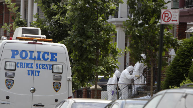 People in protective clothing enter the  house where a suspect was apprehended in connection to the murder of a missing boy in the Brooklyn borough of New York, Wednesday, July 13, 2011.  Leiby Kletzy, 8, who vanished while walking home from a day camp was killed and dismembered by a stranger he had turned to for help after getting lost, police said Wednesday.  Police Commissioner Raymond Kelly said the 35-year-old suspect, Levi Aron, made statements implicating himself in the boy's death. Formal charges are pending.(AP Photo/Seth Wenig)