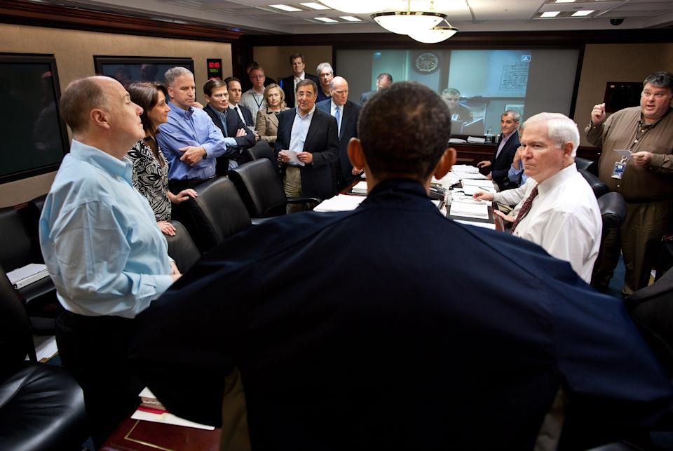 In this image released by the White House, President Barack Obama talks with members of the national security team at the conclusion of one in a series of meetings discussing the mission against Osama bin Laden, in the Situation Room of the White House, Sunday, May 1, 2011, in Washington. (AP Photo/The White House, Pete Souza)