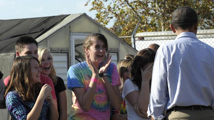 FILE - In this Oct. 18, 2011 file photo  a girl reacts after asking President Barack Obama about Justin Beiber as he visited  with Bluestone High School students in Skipwith, Va. Barack Obama: Mr. Likable. At least that's what the president's advisers hope Americans who are frustrated by the sickly economy, and looking for someone to blame, will remember when they vote next November.  (AP Photo/Susan Walsh, File)