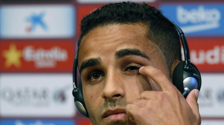 Barcelona's new soccer player Douglas attends a news conference after his presentation at Nou Camp stadium in Barcelona