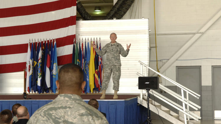 Army Gen. Martin Dempsey, the chairman of the Joint Chiefs of Staff, speaks with soldiers at Minot airforce base in Minot, N.D., on Monday, June 17, 2013. (AP Photo/Will Kincaid)