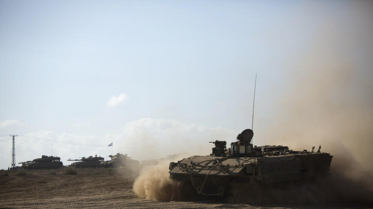 Israeli armored personnel carrier rides near the Israel and Gaza border Friday, July 25, 2014. Early Friday, Israeli warplanes struck tens of houses throughout the Gaza Strip as international efforts continue to broker a cease fire in the 18 day-old war. (AP Photo/Dusan Vranic)