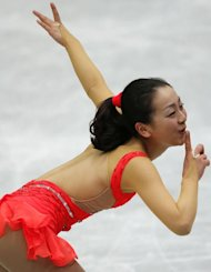 Japan's Mao Asada performs her short program in the ladies event during the Four Continents figure skating championships in Osaka on February 9, 2013. Asada landed a risky triple axel for the first time in two years to lead Japan's 1-2-3 finish