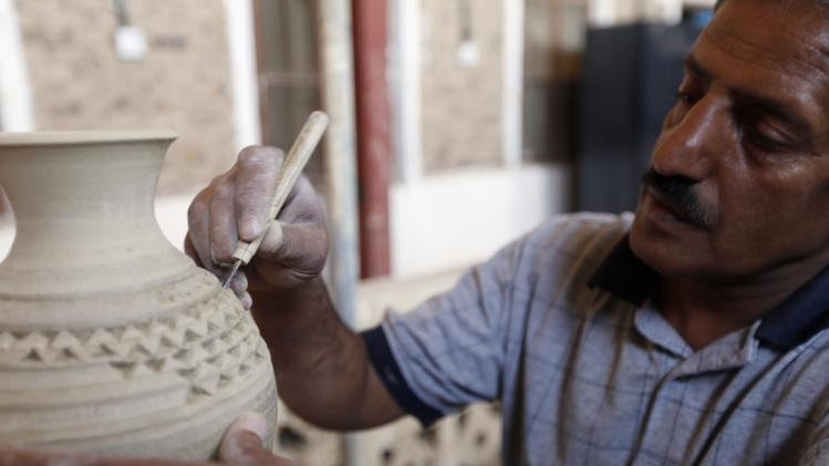 Craftsman works on pot at Dar Al-Hamd National National Centre for Yemeni handicrafts in Sanaa