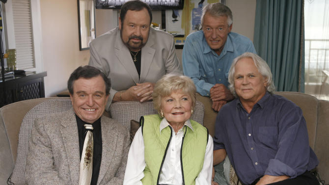 """FILE - In this Sept. 27, 2007 file photo, seated, from left, Jerry Mathers, Barbara Billingsley and Tony Dow, and, standing from left, Frank Bank and Ken Osmond, pose for a photo as they are reunited to celebrate the 50th anniversary of the television show, """"Leave it to Beaver,"""" in Santa Monica, Calif. Bank, who played oafish troublemaker Lumpy on the sitcom """"Leave It to Beaver,"""" has died. A spokesman for the Hillside Memorial Park in Los Angeles said Bank, 71, died Saturday, April 13, 2013. (AP Photo/Damian Dovarganes)"""