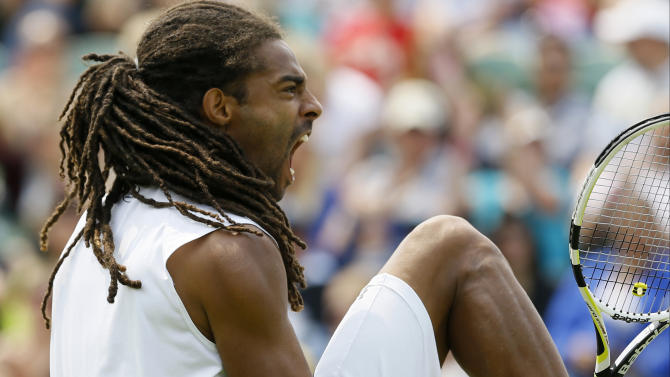 Dustin Brown of Germany reacts after winning a point against Lleyton Hewitt of Australia during their Men's second round singles match at the All England Lawn Tennis Championships in Wimbledon, London, Wednesday, June 26, 2013. (AP Photo/Kirsty Wigglesworth)